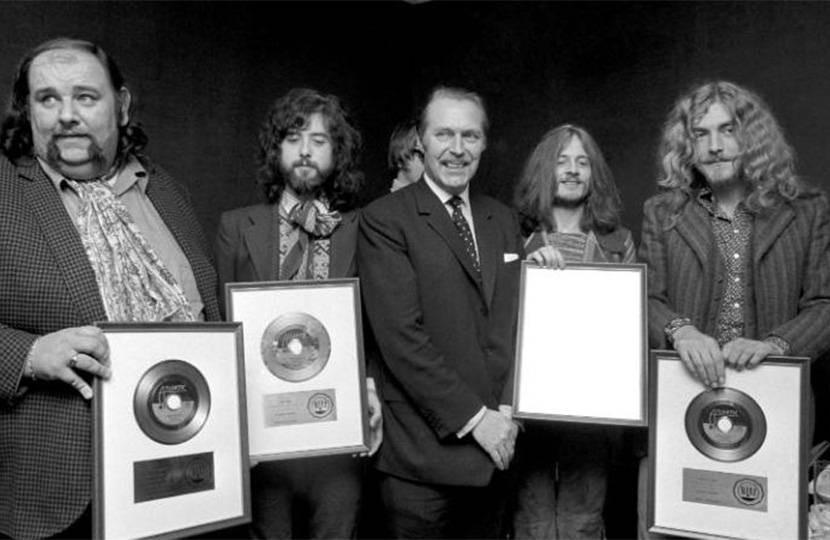 Sir Anthony Grant presenting gold discs to Led Zeppelin.